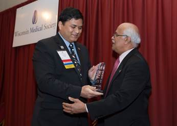 Wisconsin Medical Society President Noel Deep, MD, (left) presents the Presidential Citation award to Kesavan Kutty, MD. Photo courtesy of the Medical College of Wisconsin.
