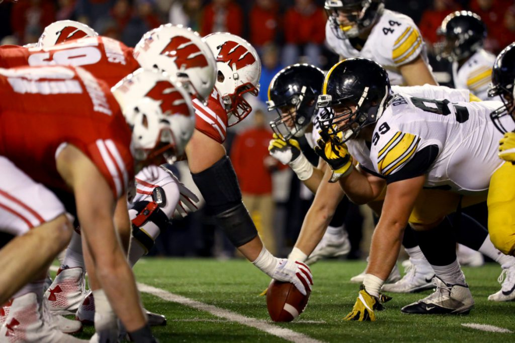 "Interviews with more than a dozen current and former Badger football players reveal that many downplay the threat of brain injury, even though some said they have had their ""bell rung"" many times. Here, the Badgers' play against Iowa on Nov. 11, 2017, in Madison. Dee Warmath, assistant professor and principal research scientist in the School of Human Ecology, is leading a study that tests different forms of concussion education on club sport athletes at UW — many of whom do not receive the same level of information about concussions. Photo by Brad Horn/For the Wisconsin Center for Investigative Journalism."