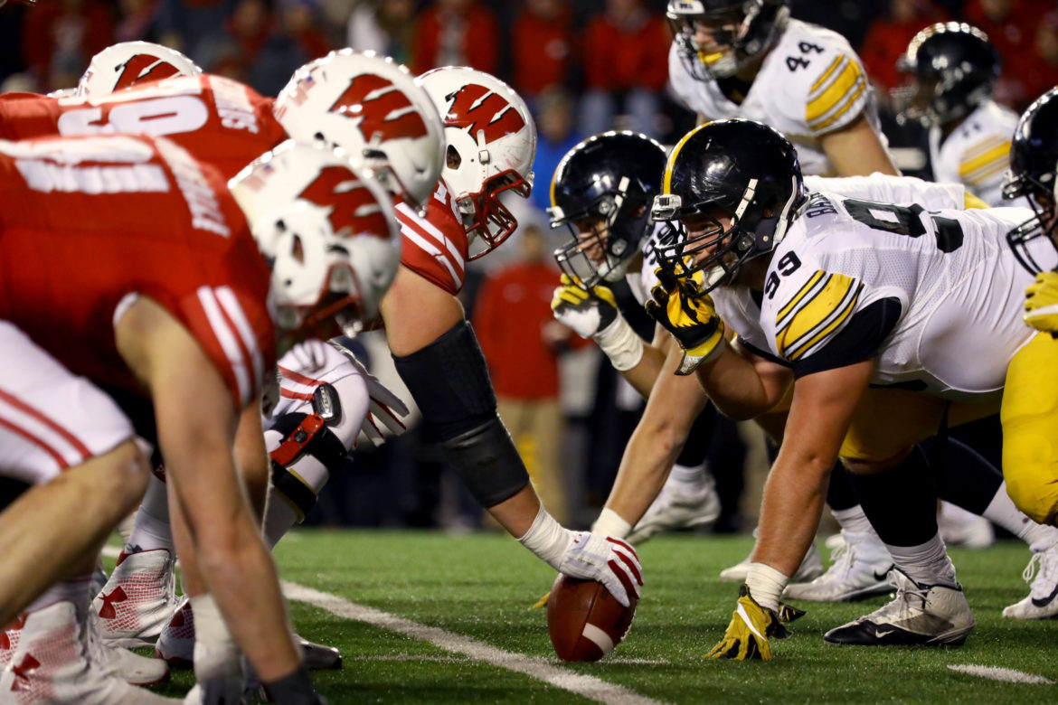 """Interviews with more than a dozen current and former Badger football players reveal that many downplay the threat of brain injury, even though some said they have had their """"bell rung"""" many times. Here, the Badgers' play against Iowa on Nov. 11, 2017, in Madison. Dee Warmath, assistant professor and principal research scientist in the School of Human Ecology, is leading a study that tests different forms of concussion education on club sport athletes at UW — many of whom do not receive the same level of information about concussions. Photo by Brad Horn/For the Wisconsin Center for Investigative Journalism."""
