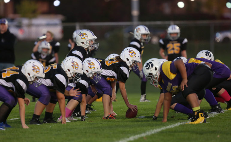 Sixth graders play at Warner Park in Madison, Wis., on Oct. 18, 2017. Participation in youth tackle football has declined recently in part because of concerns over brain injuries. Photo by Michelle Stocker / The Cap Times.