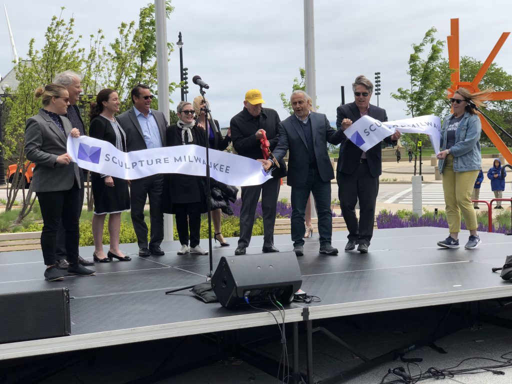 Stephen Marcus cutting the ribbon for the 2018 Sculpture Milwaukee exhibit. Photo by Jeramey Jannene.