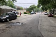 A large pothole on S. 25th St. just south of W. Greenfield Ave. Photo by Jeramey Jannene.