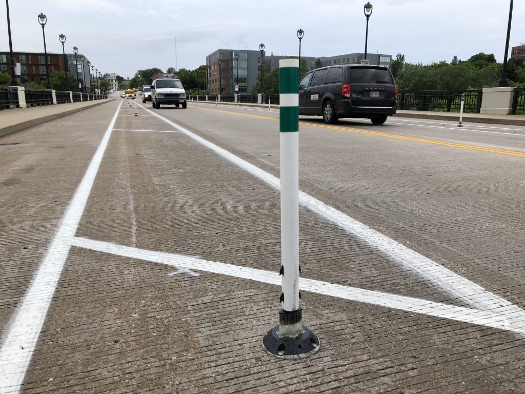Bollard in North Ave. Bridge Protected Bike Lane. Photo by Jeramey Jannene.