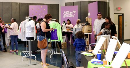 Shoppers browse merchandise at Natural E Beautiful. Photo by Sophie Bolich.