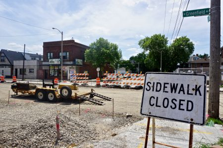 When the project is completed in November, Greenfield Avenue will have an 11-foot wide driving lane, an 8-foot wide parking lane and a 5-foot wide bicycle lane in each direction. Photo by Abby Ng.