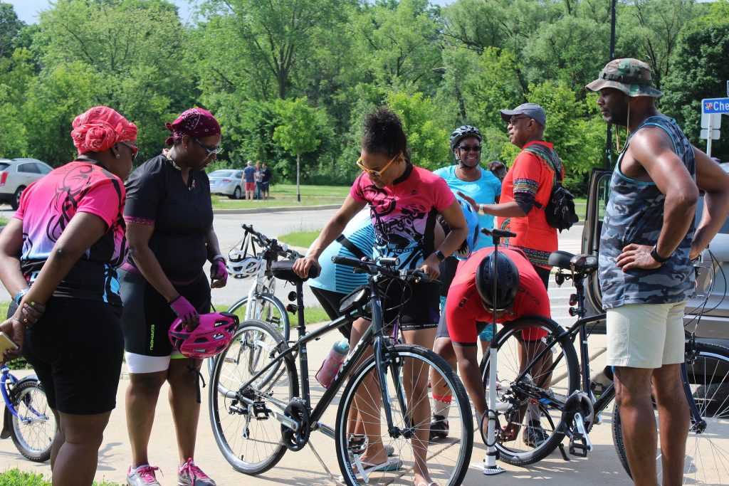 BGDB co-Leader Tonieh Welland (center) prepares a bike before the ride. Photo by Mary Bolich.