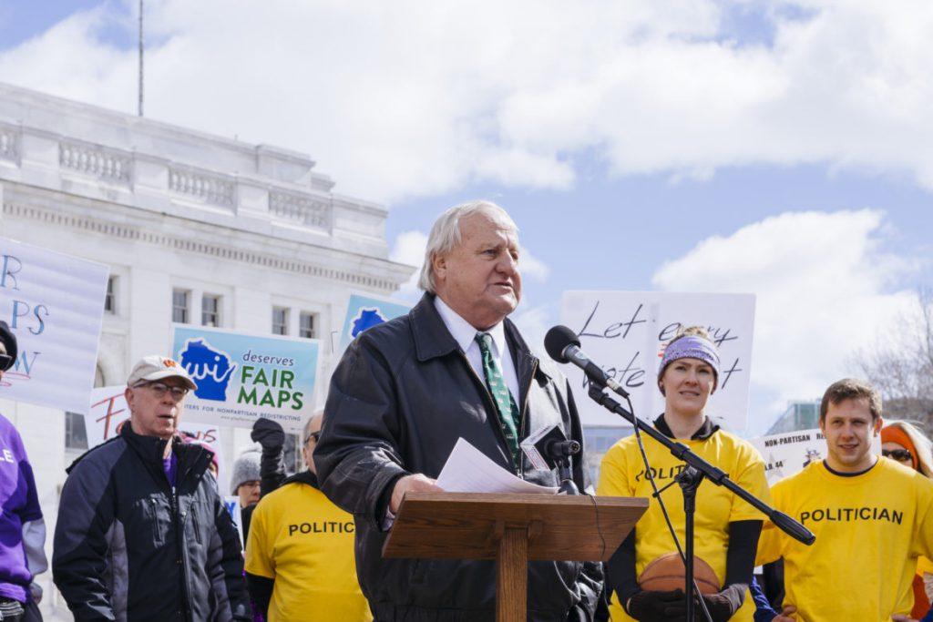 State Sen. Dave Hansen, D-Green Bay, speaks at Maps Madness: Voters vs. Politicians, a rally organized by the Wisconsin Fair Maps Coalition outside the Wisconsin state Capitol on March 7, 2018. The rally was an unsuccessful effort to convince legislators to hold a special session on a bill sponsored by Hansen calling for a nonpartisan redistricting process. Photo by Cameron Smith/Wisconsin Center for Investigative Journalism.