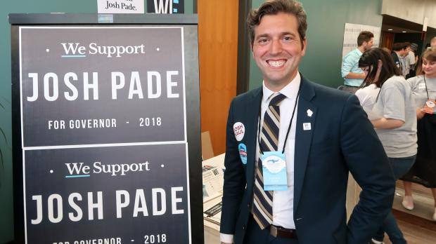 Josh Pade stands next to his campaign's table at the Democratic State Convention on June 1, 2018, in Oshkosh. Shawn Johnson/WPR.