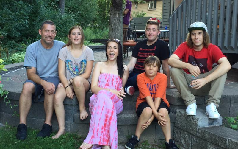 Clint Ruesch with his children in 2017. Photo courtesy of Ruesch.