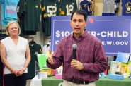 Gov. Scott Walker promotes the state's child tax credit during a stop in Sussex. Shawn Johnson/WPR