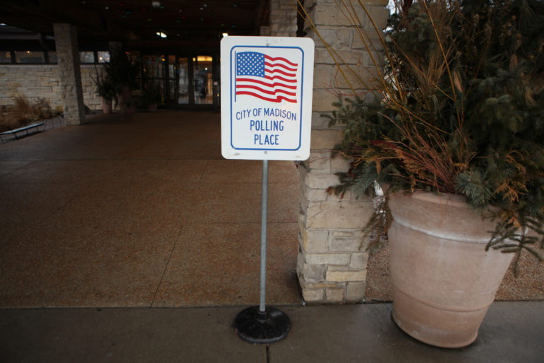 Wisconsin's 2011 redistricting is under challenge in a U.S. Supreme Court case, which the plaintiffs argue discriminates against Democratic voters to create a persistent Republican majority in the Legislature. Here, a voting sign is seen at the polling place at Olbrich Gardens on Feb. 20, 2018, in Madison. Photo by Coburn Dukehart / Wisconsin Center for Investigative Journalism.