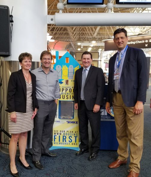 (l-r) Kathryn Dunn from the Greater Milwaukee Foundation, Chris Abele, Housing Administrator James Mathy and Airport Director Brian Dranzik. Photo from Milwaukee County.