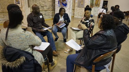 Community members discuss the DOJ draft report at the Wisconsin Black Historical Society on March 25. Photo by Andrea Waxman.