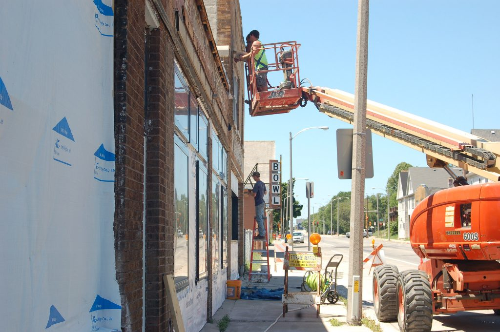 Construction workers renovate the exterior of Pete's Pops, which is set to open Aug. 11th. Photo by Jenny Whidden.