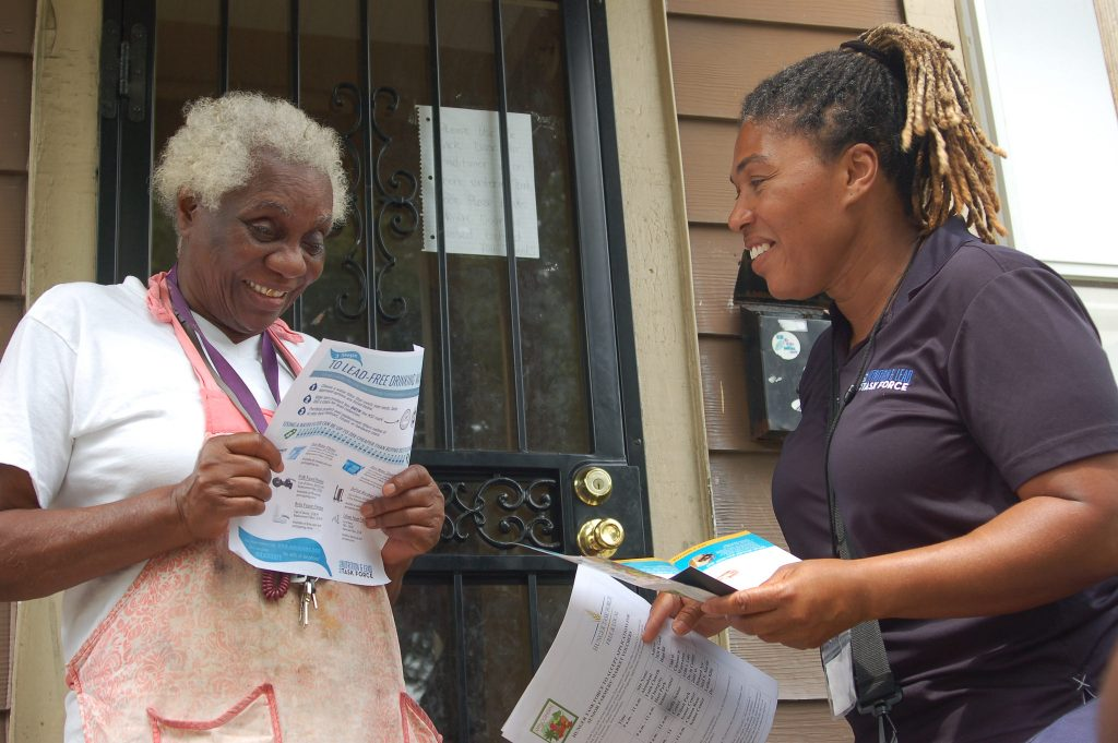 Dorothy Smith, 73 (left) and task force canvasser Marsha Ashley talk about lead prevention. Photo by Jenny Whidden.