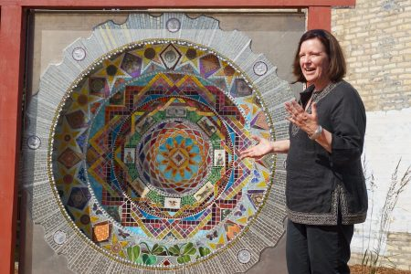 Landscape designer Rosheen Styczinski discusses the symbolism of Catherine Lottes' piece on 35th Street and National Avenue. Photo by Abby Ng.