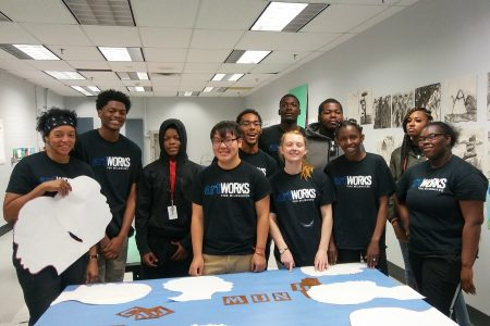 From left, ArtWorks artist Blanche Brown with interns Octaivian McCollum, Joshua McCollum, Salman Lee, Andrew Nash, Emily Moore, Brandon Robinson, Bradley Robinson, Celeste Beals, Kashmiara Jackson and Ashanti Weeks. Photo courtesy of Kristen Fledderjohn.