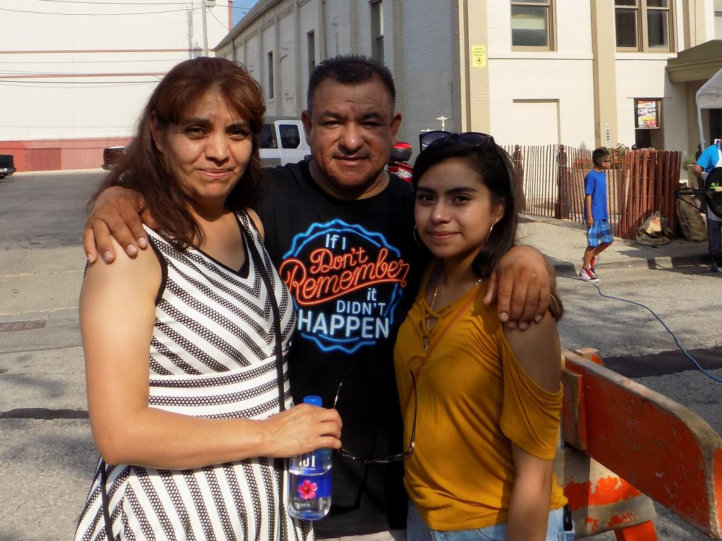 Daniela Garcia, right, and her family at a block party at St. Anthony School Milwaukee. Photo by Ximena Conde/WPR.