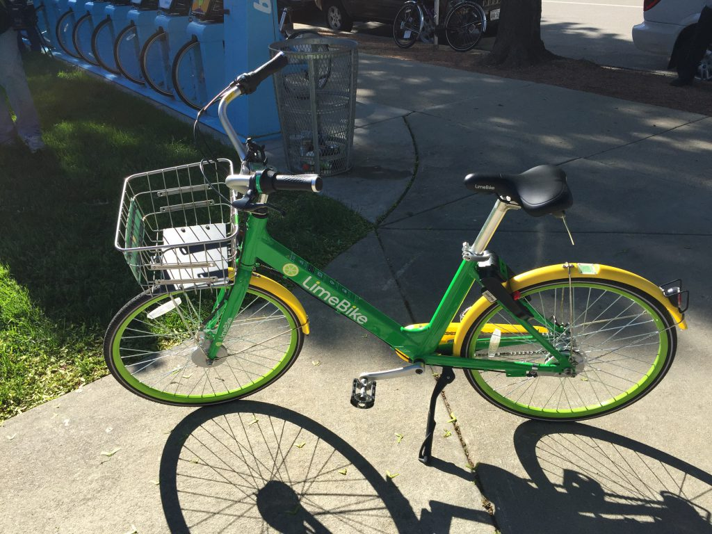 A LimeBike dockless bike share bicycle in Milwaukee. Photo by Dave Reid.