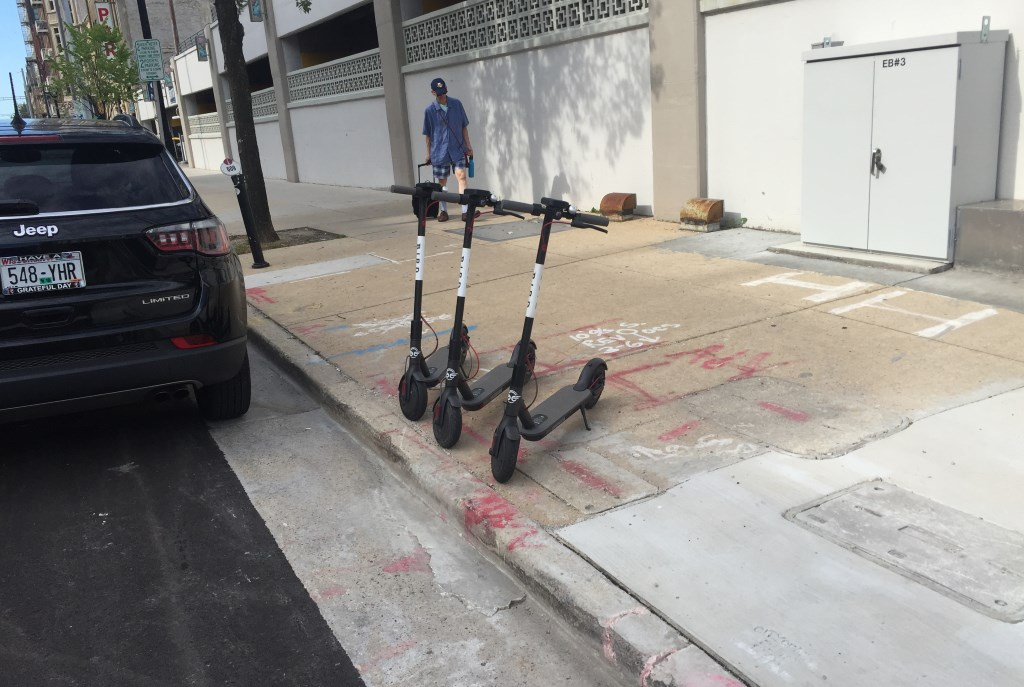 Three of Bird's scooters were parking on N. Milwaukee St. on the morning of July 9th, 2018. Photo by Dave Reid.