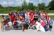 Walker poses with well-wishers before a parade in Franklin on Wednesday. Photo by Chuck Quirmbach/WPR.