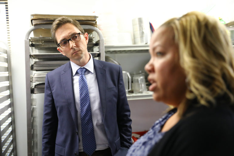 Brandon Lipps, acting deputy undersecretary of the U.S. Department of Agriculture, meets with Carmella Glenn, Just Bakery program coordinator, on June 5, 2018, in Madison, Wis. Just Bakery is a 16-week educational and vocational training program that works with people who have barriers to employment including homelessness, criminal history, mental health problems or lack of transportation. Some of the trainees participate to keep government food assistance, known as FoodShare. Photo by Coburn Dukehart/Wisconsin Center for Investigative Journalism.