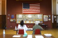 Julie Routhieaux, administrative specialist for the village of Little Chute, Wisconsin, left, and Patti Seeman, an election inspector, help out with voting at the village hall for a special election in the 1st Senate District on June 12, 2018. Democrat Caleb Frostman beat Republican Andre' Jacque for the state Senate seat. A judge had ordered Gov. Scott Walker to call a special election for the seat after the former office holder, Republican Frank Lasee, resigned in December to take a job with the state. Photo by Coburn Dukehart/Wisconsin Center for Investigative Journalism.