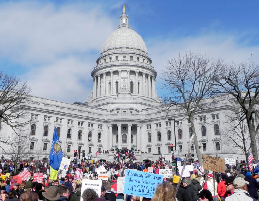 After Gov. Scott Walker unveiled the Wisconsin budget repair bill in February 2011, which sought to end collective bargaining for most public sector unions, thousands of protesters took to the streets of Madison in opposition. Protestors are seen here in front of the Wisconsin State Capitol on March 12, 2011, a day after the bill was passed. A recent poll found that over two-thirds of Democrats, Republicans and independents feel very or somewhat concerned about the current state of American democracy. Photo by Richard Hurd. (CC BY 2.0)