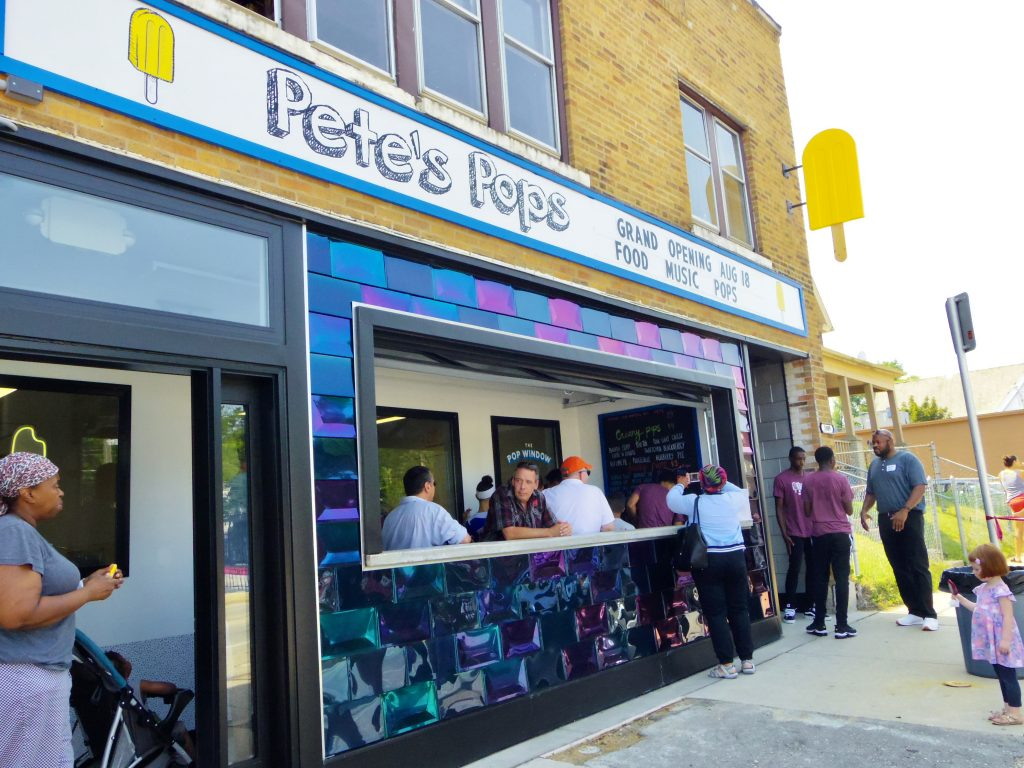 Community members gather for the grand opening of the new Pete's Pops storefront on the Near West Side. Photo by Robyn Di Giacinto/NNS.