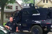 An armored vehicle is parked outside a residence on North 33rd Street. Photo by Gab Taylor via ComForce/NNS.