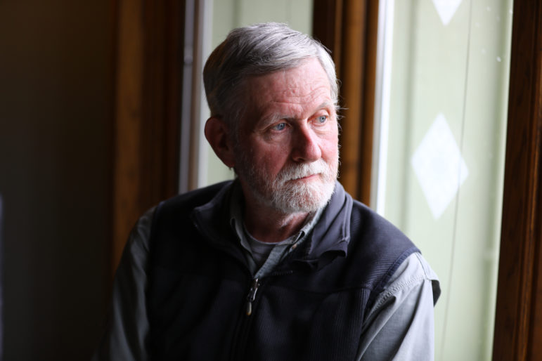 "Robert Rolley, a retired Wisconsin Department of Natural Resources wildlife research biologist, says he has seen regular citizens lose influence over natural resource decisions. He is seen here at his home in Baraboo, Wis., on May 21, 2018. ""There is a long history in the DNR of listening to public input prior to making management decisions,"" says Rolley, who worked at the agency for 25 years. ""What has changed is which citizens the DNR Board and administration is interested in listening to."" Photo by Coburn Dukehart / Wisconsin Center for Investigative Journalism."