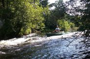 Spencer Black paddles the Namekagon River. Photo by Daryl Hinz.