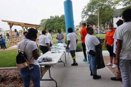 Volunteers at Big Clean MKE hand out t-shirts at the Fondy Food Center. Photo by Sarah Lipo/NNS.
