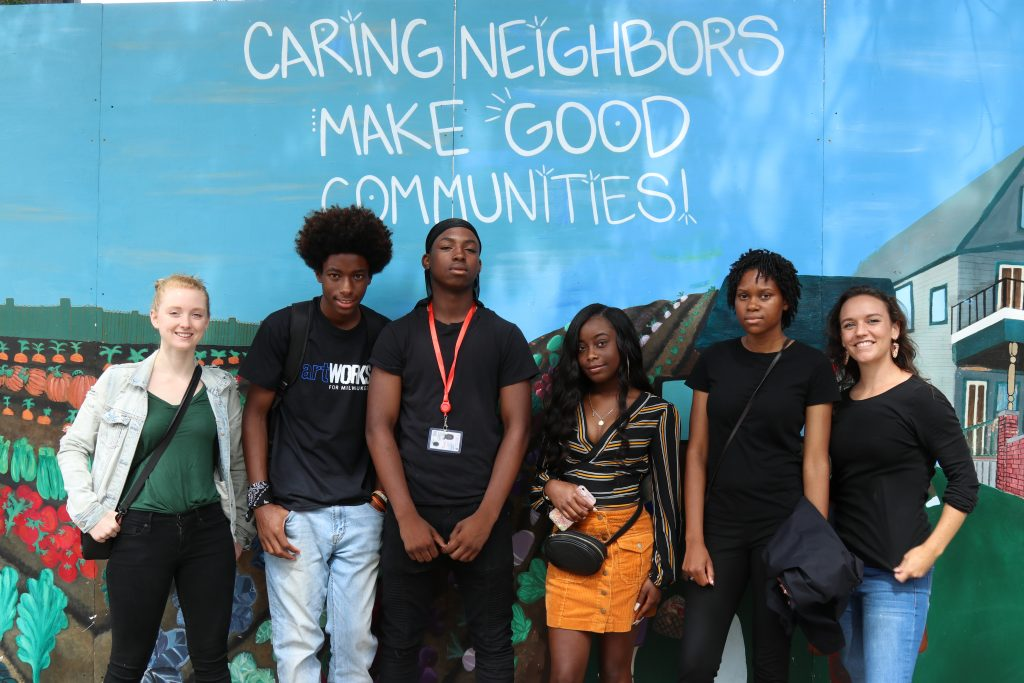 "From left, Emily Moore, Qaamar Morehouse, Brandon Carson, Jr., Quin'Niya Richardson, Shavante Grant and Christina Theobald helped restore the ""Caring Neighbors"" mural. Photo by Grace Connatser/NNS."