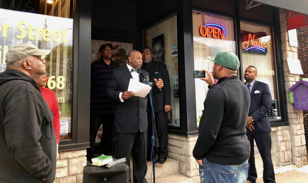 RP Potts speaks in front of Center Street Nail Bar, his wife's business. Photo by Sophie Bolich/NNS.