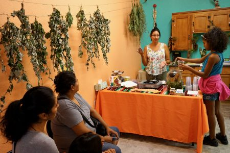 Angela Kingsawan (behind table) sells her Yenepa Herbals products at a storefront at 1008 S. Cesar E. Chavez Drive. Photo by Adam Carr/NNS.