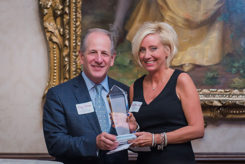 Peggy Williams-Smith receiving her honor from Greg Marcus, president and chief executive officer of The Marcus Corporation. Photo courtesy of The Marcus Corporation.