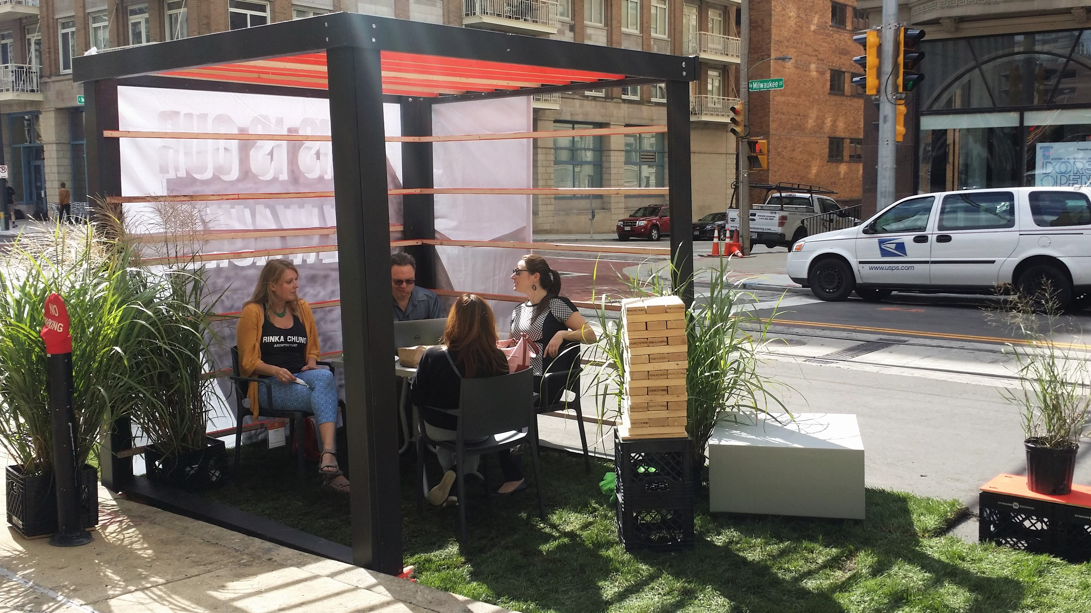 People sit at the Rinka Chung Architecture parklet. Photo by Jack Fennimore.