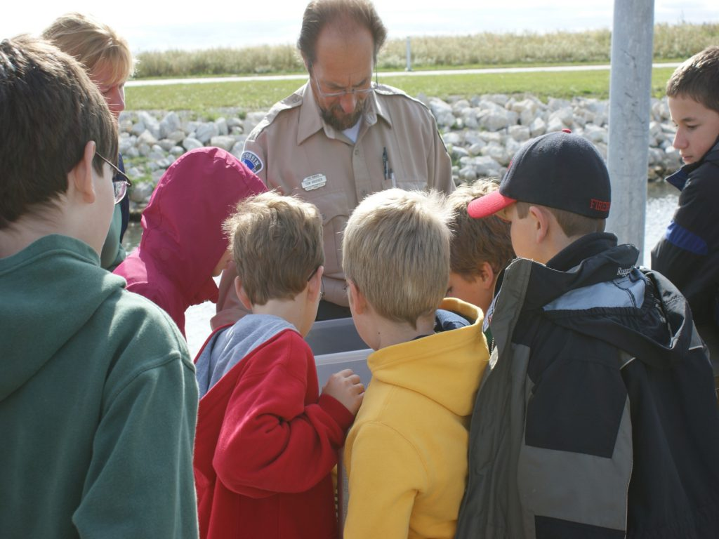 Tom Kroeger of the DNR teaching a group of children. Photo courtesy of the Friends of Lakeshore State Park.