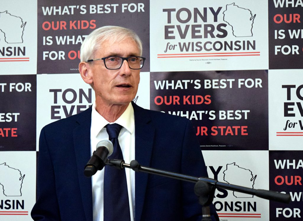The relative lack of rules dictating how elected officials like State Supt. Tony Evers spend their time may reflect an acknowledgement that everything they do is to some extent political. Evers, photographed after his victory in the Democratic primary for governor at Park Hotel in Madison on Aug. 14, 2018, alludes to his longtime role in education in his campaign materials. Photo by Elizabeth Dohms/Wisconsin Public Radio.