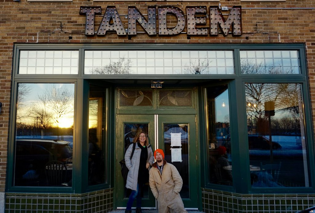 Co-developers Juli Kaufmann and Jeremy Davis pose in front of the Tandem restaurant in the historic tavern building they redeveloped. Photo by Allison Dikanovic/NNS.