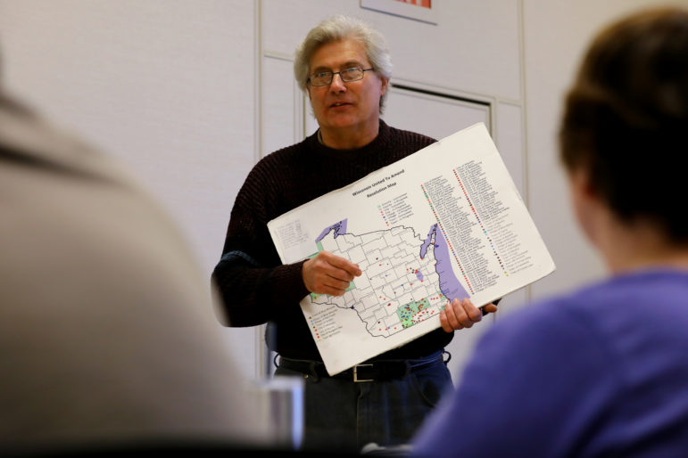 George Penn, a volunteer with South Central Wisconsin United to Amend, presents to the group at the Sequoya Library in Madison, Wis., on April 10, 2018. The nonpartisan citizens group meets twice a month to discuss ways to overturn the U.S. Supreme Court's 2010 Citizens United decision that loosened restrictions on campaign contributions. Photo by Coburn Dukehart / Wisconsin Center for Investigative Journalism.
