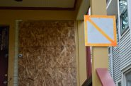 A white placard with one or two orange slashes warns firefighters about potential dangers in abandoned or vacant buildings. Photo by Analise Pruni/NNS.