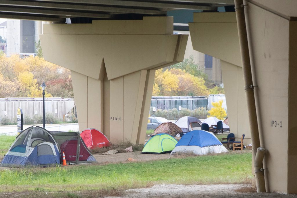 Tent camps are set up by homeless people under the highway at 6th street between Michigan and St. Paul streets. Photo courtesy of NNS.