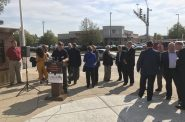 Local leaders gather in front of a Walgreens in West Allis. Photo by Graham Kilmer.