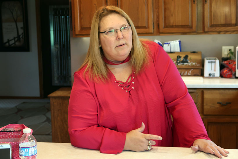 Erika Balza says her well in Kewaunee County has been contaminated with nitrates, bacteria and manure because of farming practices and the region's fractured bedrock. Photo by Danielle Kaeding/WPR.