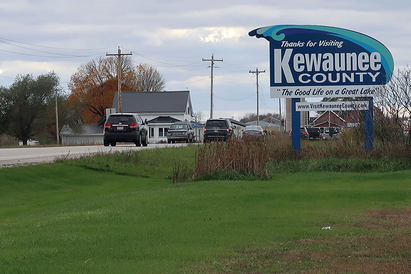 "A sign reads ""Thanks for visiting Kewaunee County."" The county has become the poster child for water quality concerns in Wisconsin. Photo by Danielle Kaeding/WPR."