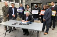 Mayor Tom Barrett signs Complete Streets legislation surrounding by supporters. Photo by Jeramey Jannene.
