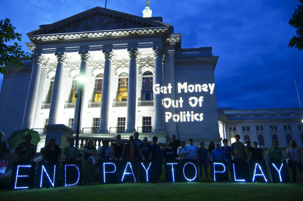 Get Money Out Of Politics. Photo courtesy of Wisconsin United To Amend.