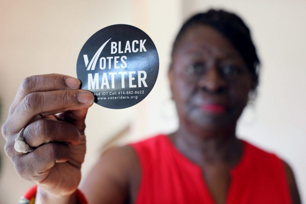 Anita Johnson of Milwaukee, Wis., helps residents comply with the state's voter ID law through the nonprofit group VoteRiders. Johnson says she is certain Wisconsin's requirement that voters show a photo ID at the polls suppressed turnout in the 2016 general election. Photo by Dee J. Hall/Wisconsin Center for Investigative Journalism.